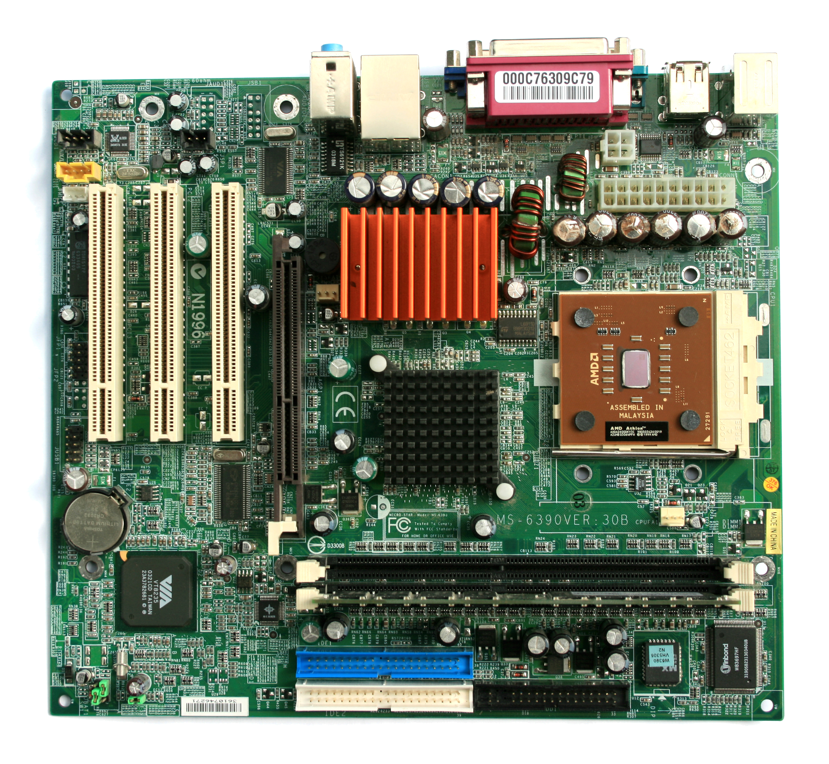 A microATX motherboard with some faulty capacitors.