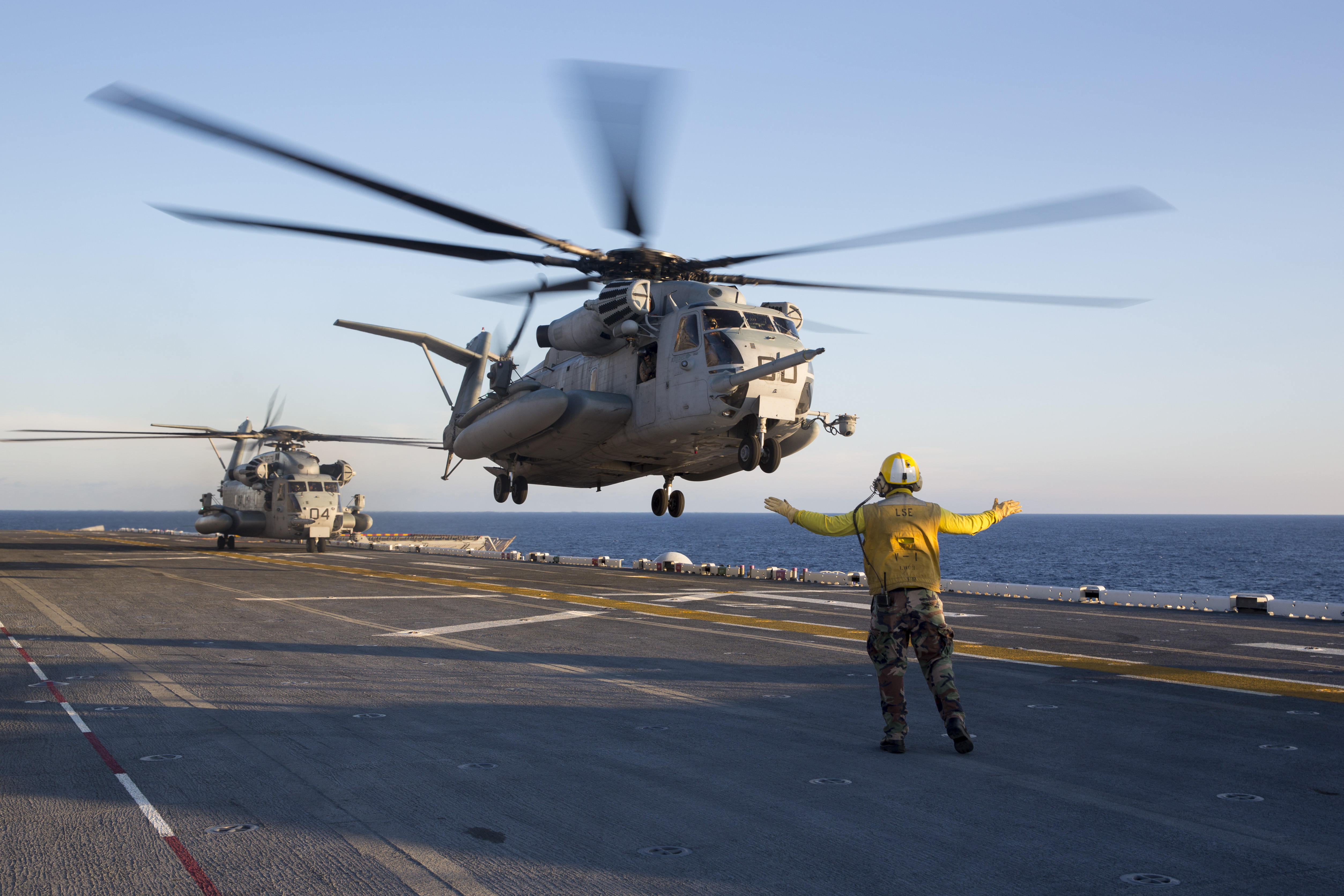 File:A U.S. Sailor directs a Marine Corps CH-53E Super Stallion helicopter to