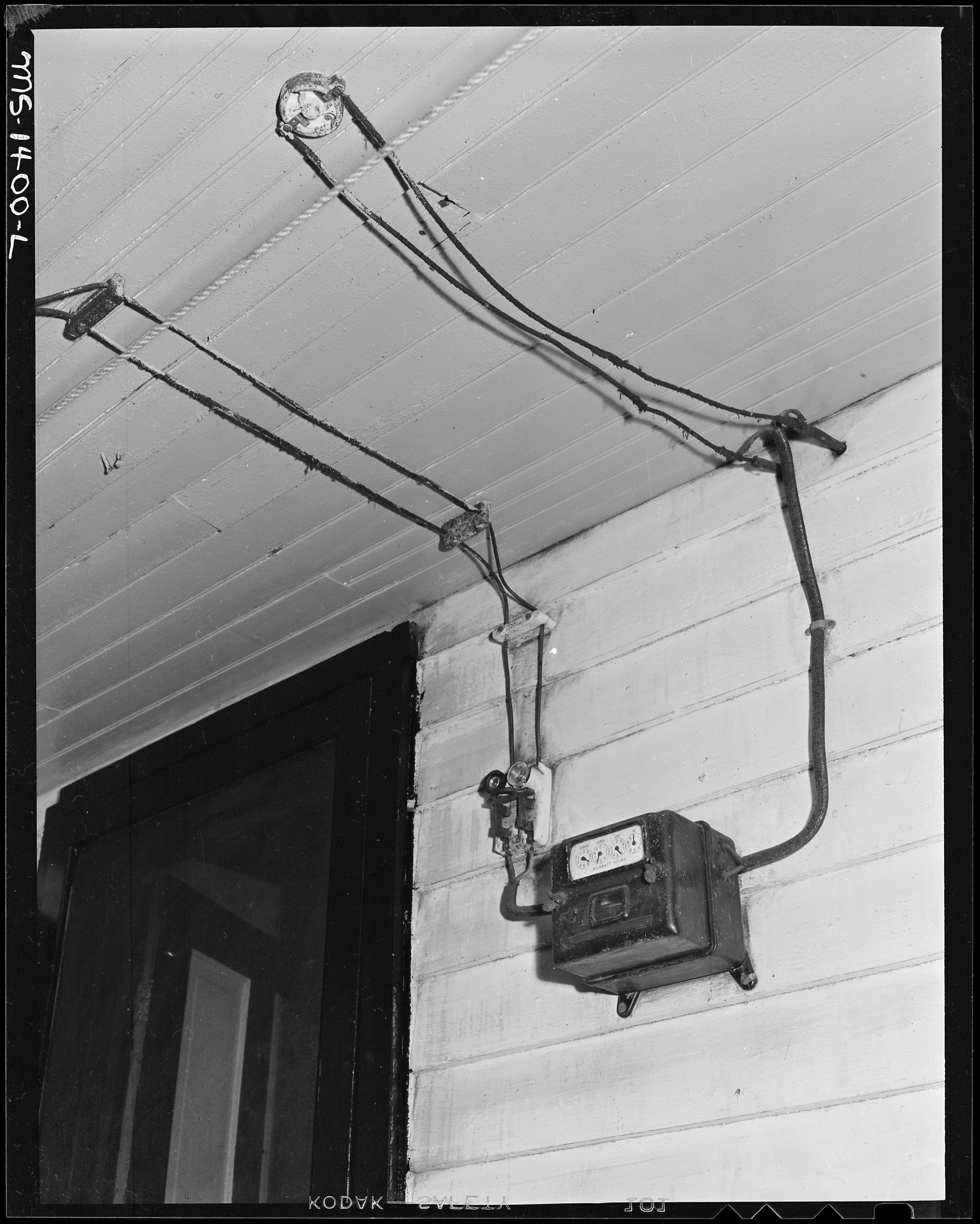 File:Electricity meter and wiring on the porch of house occupied by James  Robert Howard