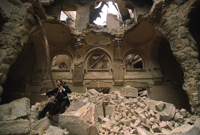 Vedran Smailović playing in the partially destroyed National Library in Sarajevo in 1992