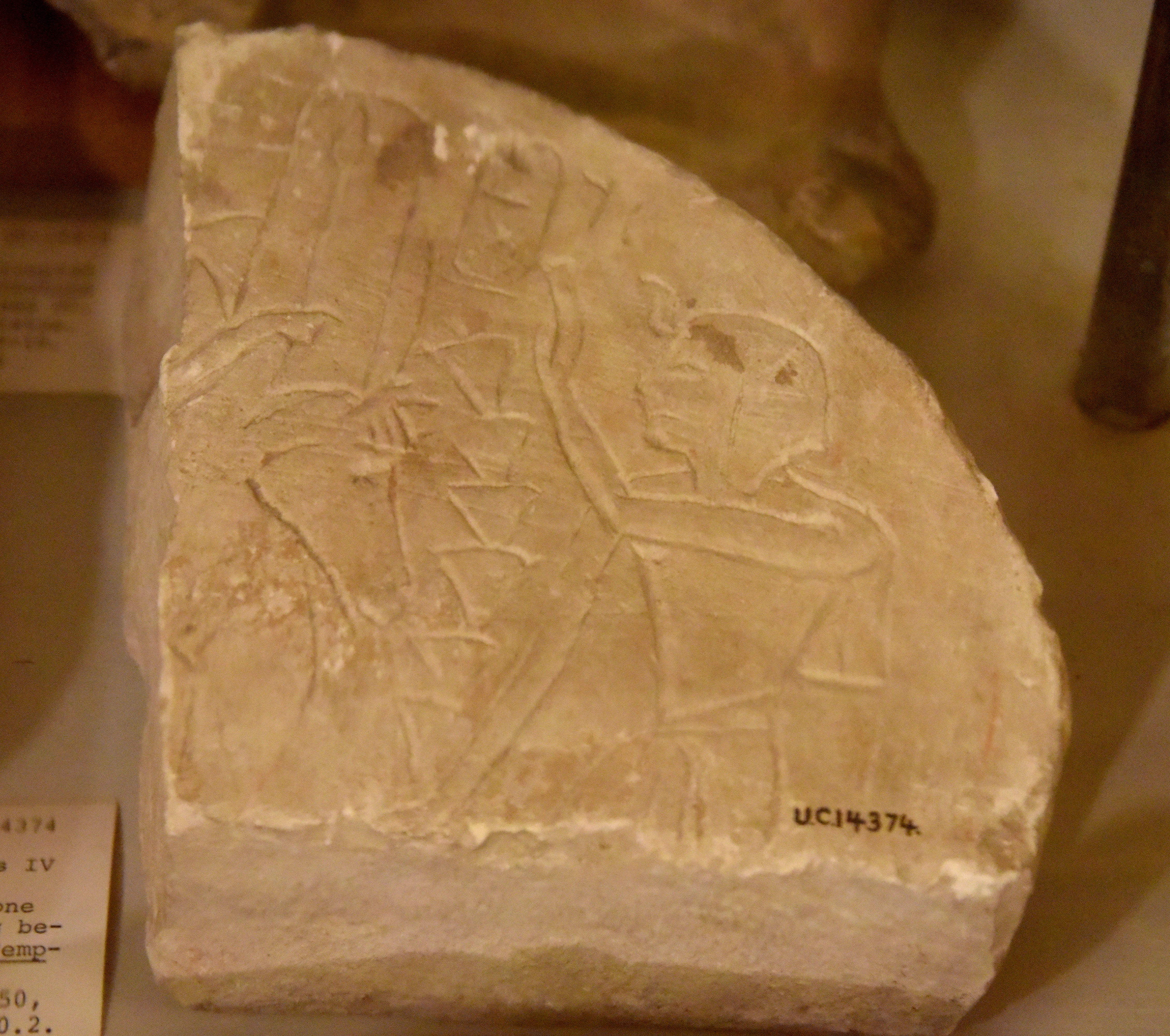 fragment of a crudely carved limestone stela showing king thutmose iv adoring a goddess (probably astarte). from thebes, egypt. 18th dynasty. the petrie museum of egyptian archaeology, london.jpg