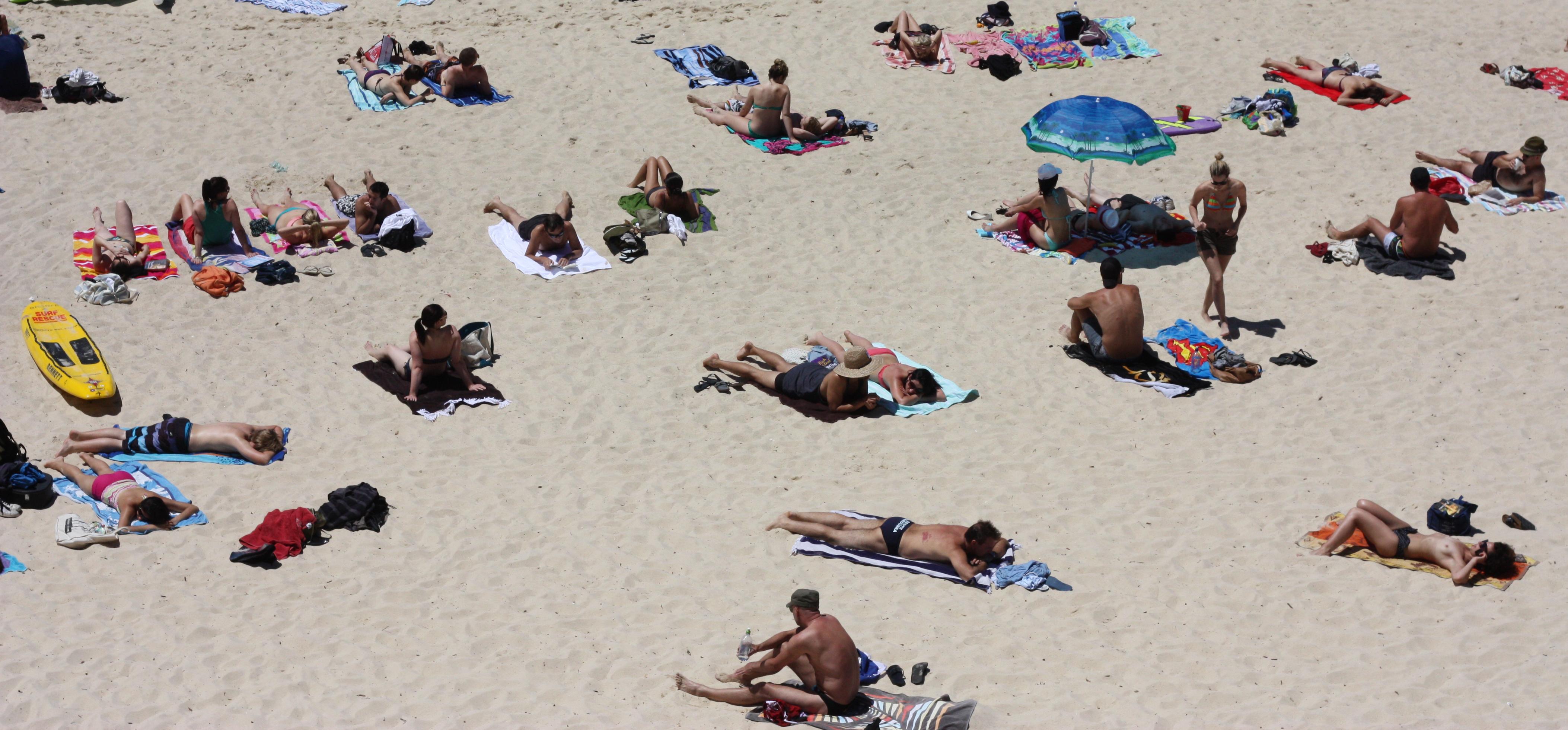 Sunbathers On The Beach Best Beaches In World