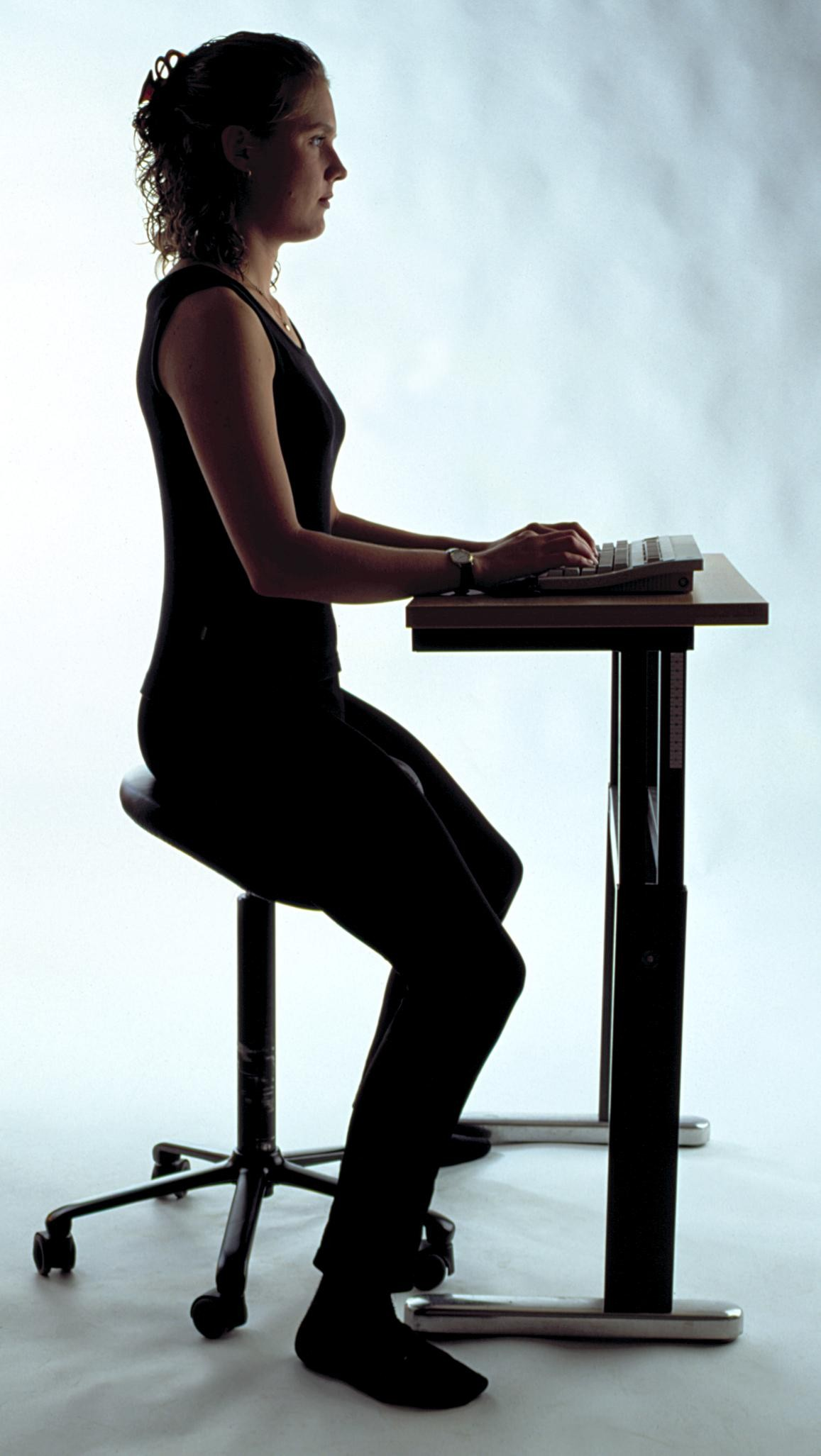 Woman practicing a good sitting posture.