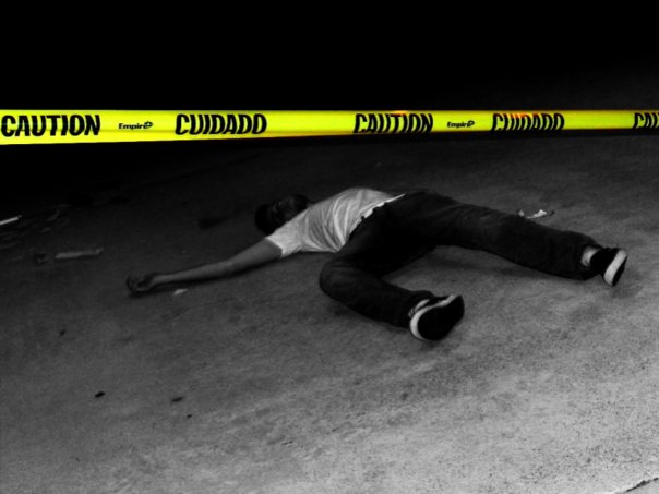 Actor lying behind caution tape