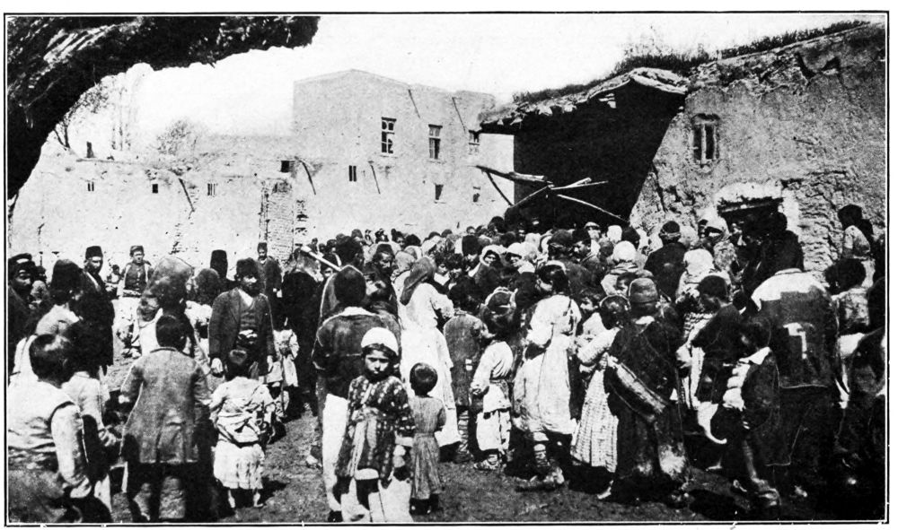 Armenian refugees at Van crowding around a public oven during 1915.png