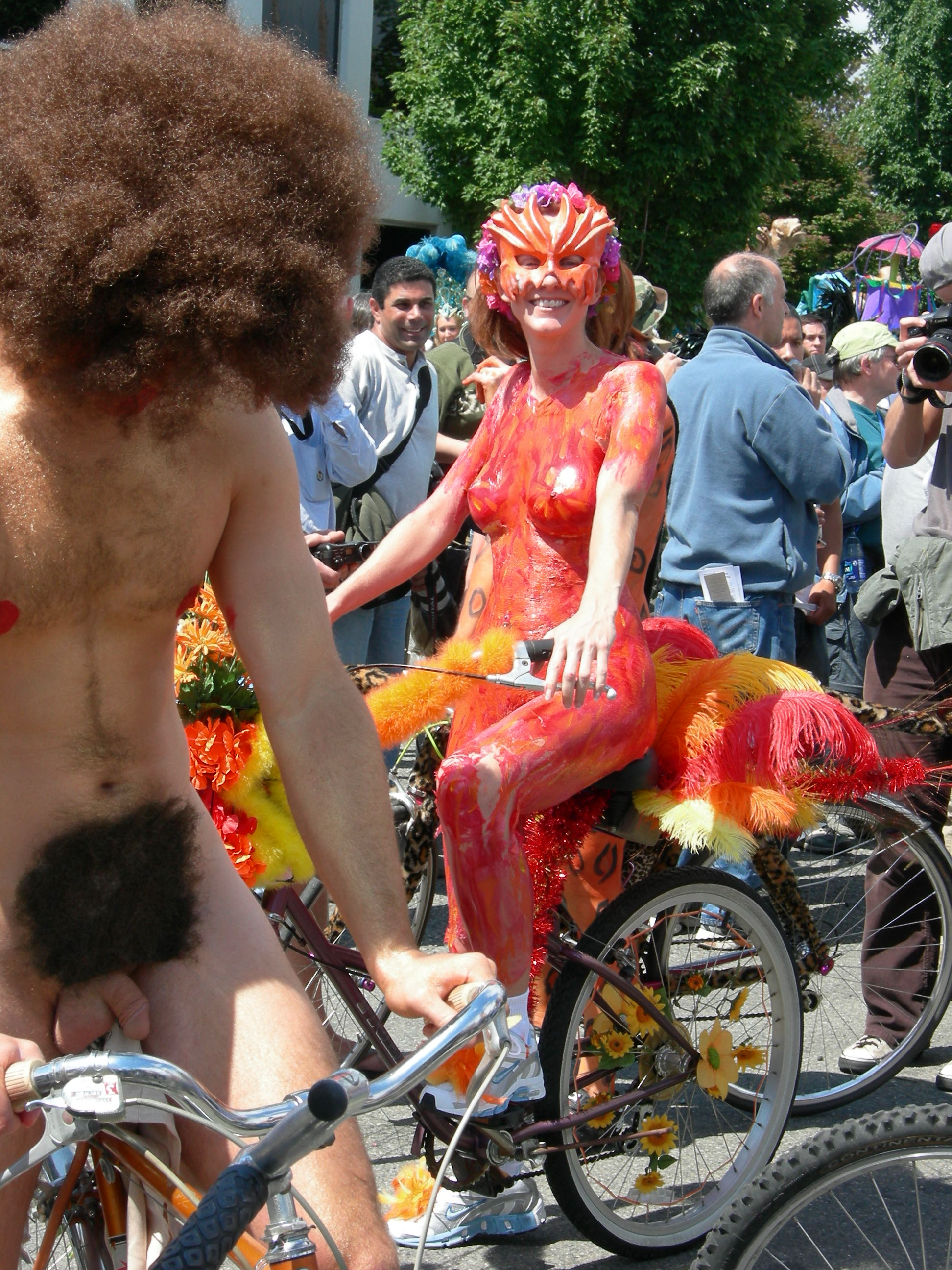 http://upload.wikimedia.org/wikipedia/commons/d/df/Fremont_Fair_2007_pre-parade_naked_cyclists_07.jpg