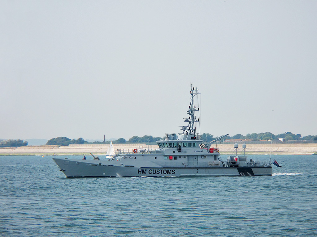 HMC Vigilant, one of several customs cutters of the UKBA, capable of speeds up to 26 knots departing Portsmouth Naval Base.