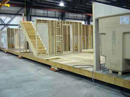 File interior walls set on modular home floor Mobile home interior walls