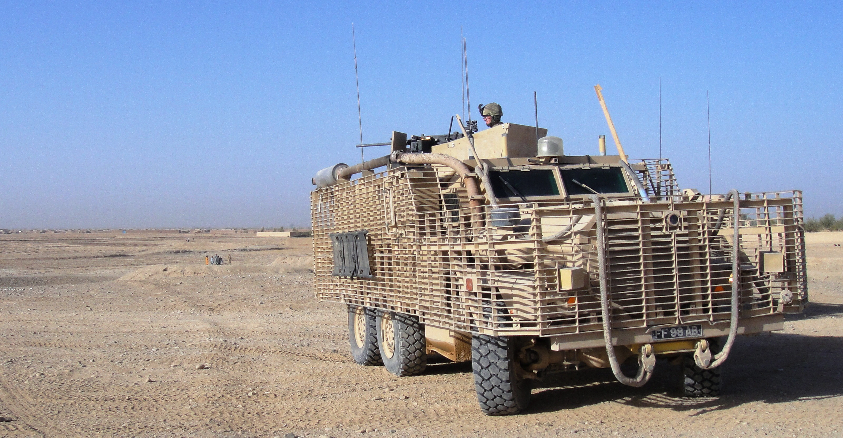 File:HGV Passes Mastiff Armoured Vehicle in Basra MOD 45149766.jpg ...