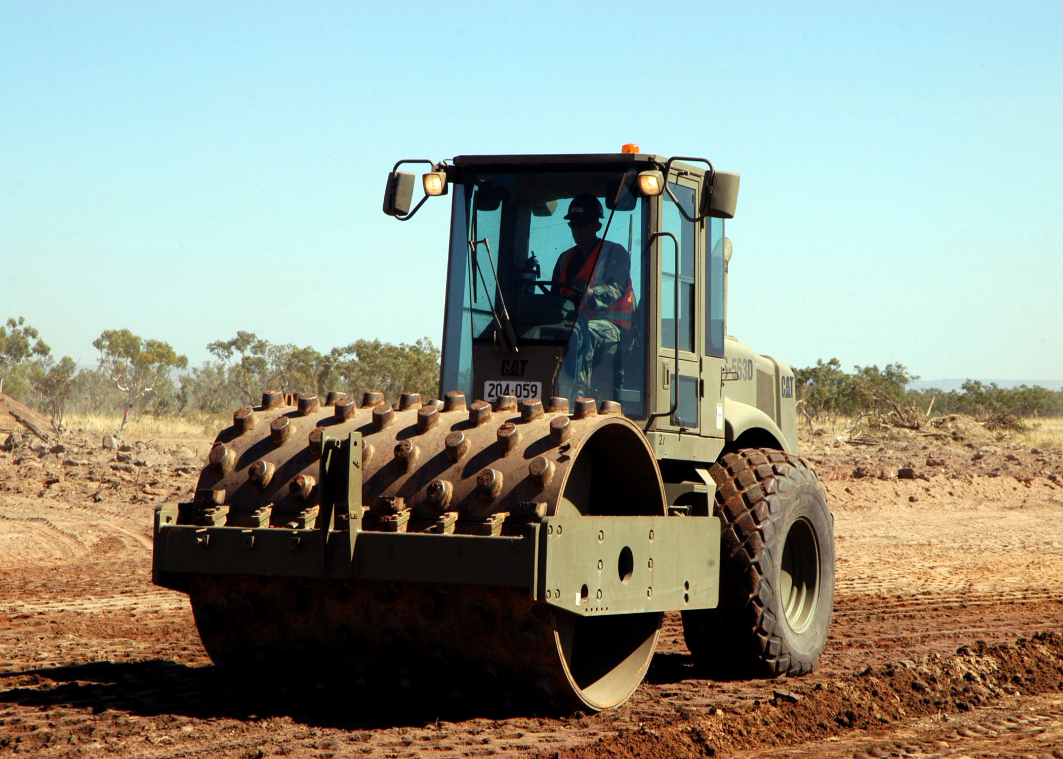A compactor/roller operated by U.S. Navy Seabees