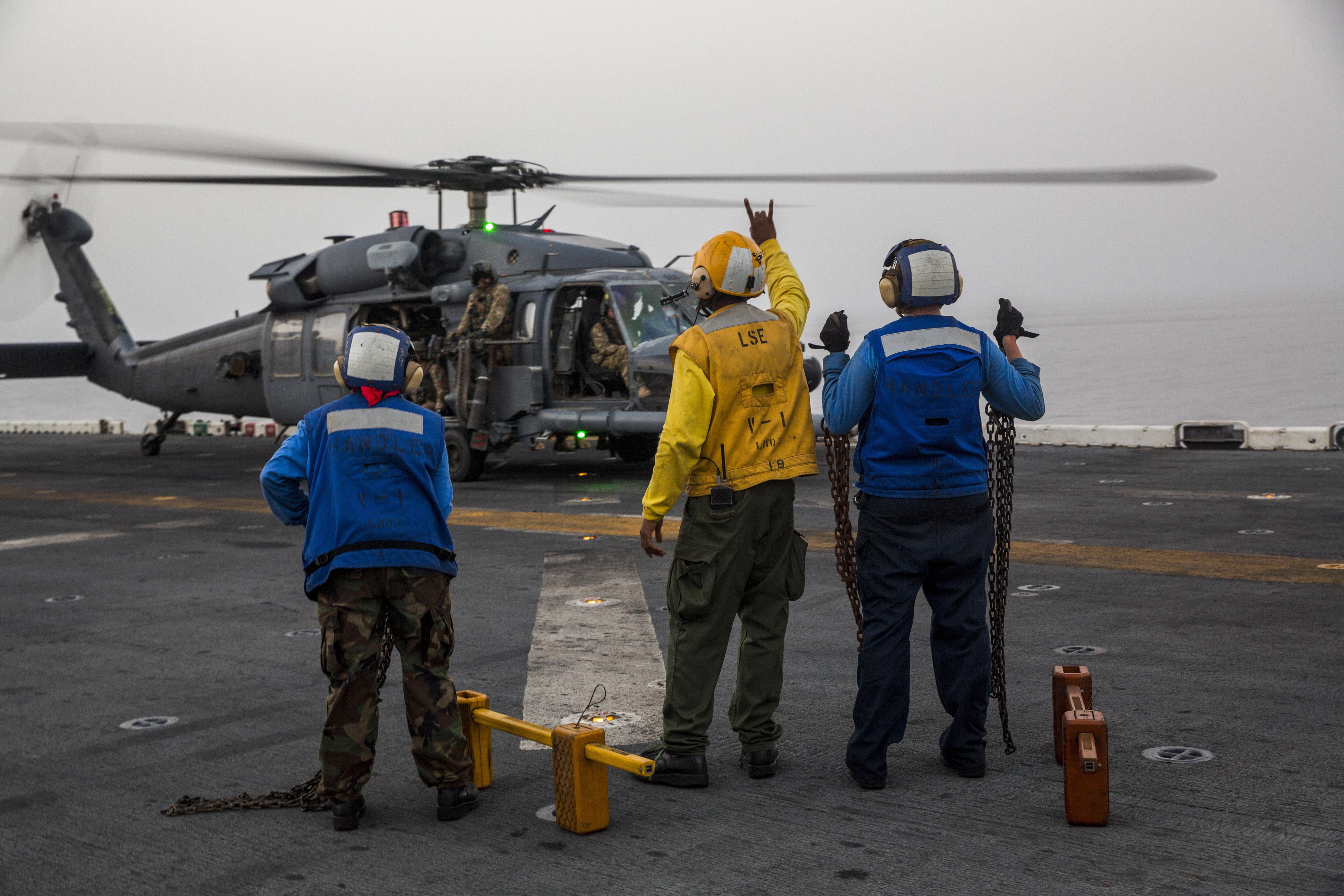 File:A U S  Navy aviation boatswain's mate, in yellow shirt