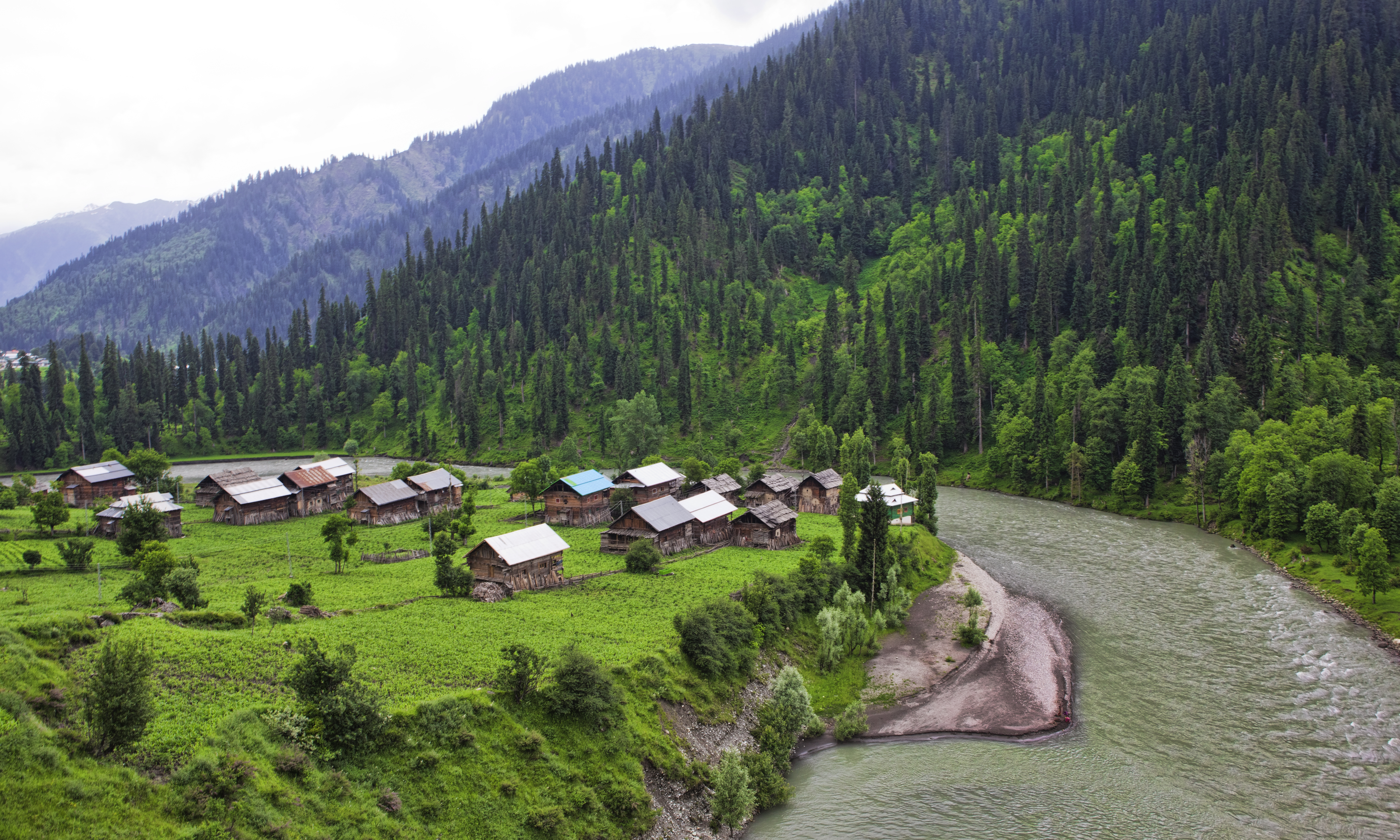 Mission: Traveling Unknown Lands 1 - Page 2 A_small_village_on_the_banks_of_Neelam_River_in_Grace_%28AKA_as_Grase%29_valley%2C