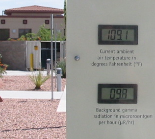The weather station outside of the Atomic Testing Museum on a hot summer day. Displayed background gamma radiation level is 9.8 mR/h (0.82 mSv/a) This is very close to the world average background radiation of 0.87 mSv/a from cosmic and terrestrial sources. Atomic Testing Museum weather display cropped.jpg