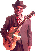 Brown with his signature blonde Gibson ES-175