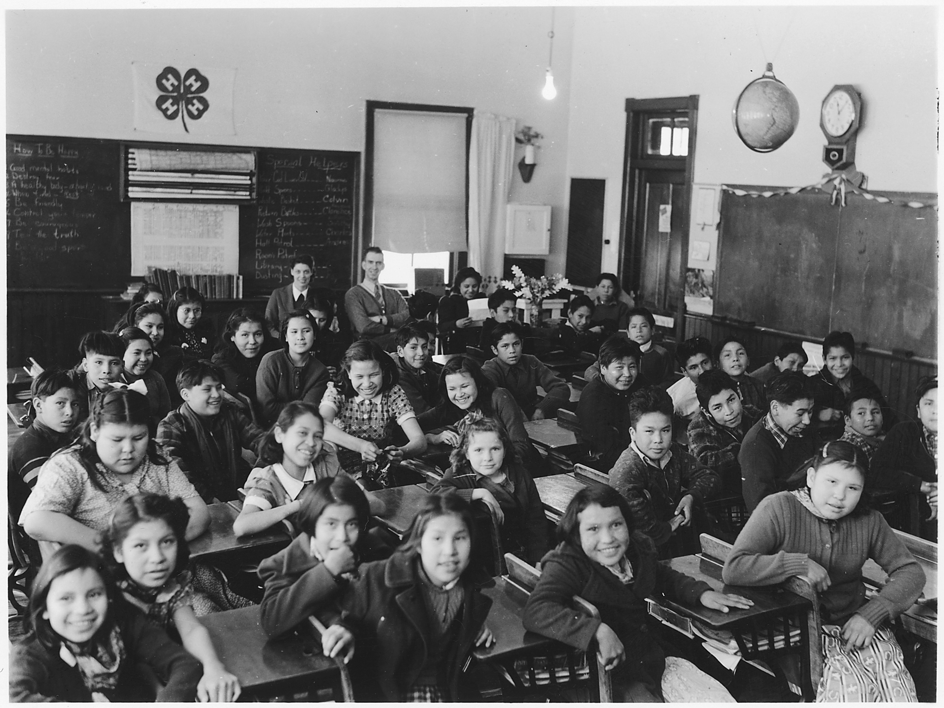 Picture of kids at desks in a crowded class