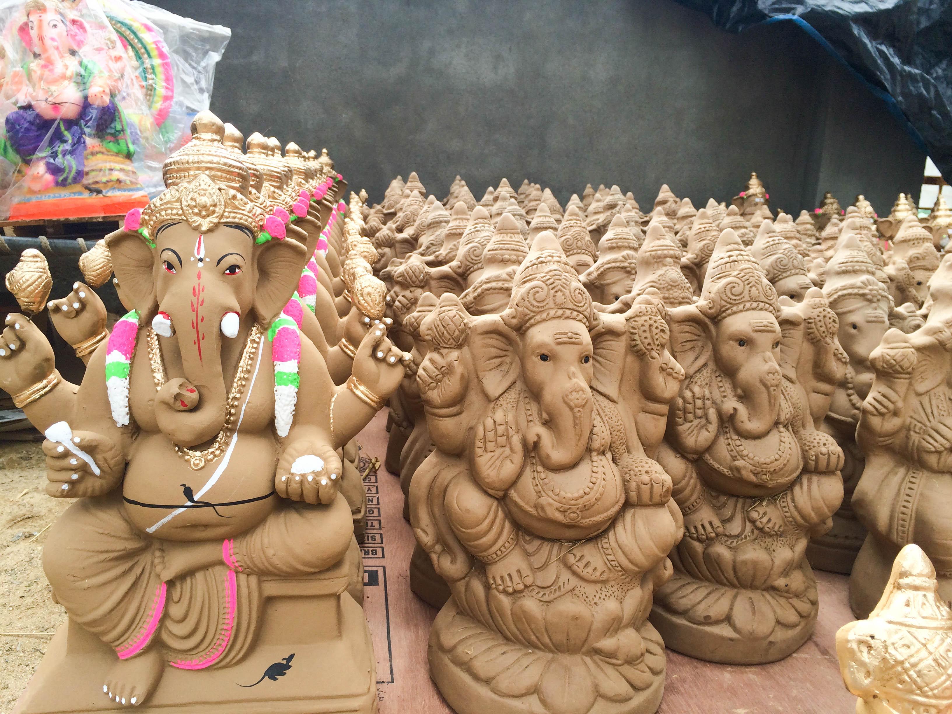 file:clay images of god ganesh on display at a ganesh chaturthi shop