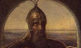 Head and shoulders of bearded man in the gloom, wearing a medieval helmet