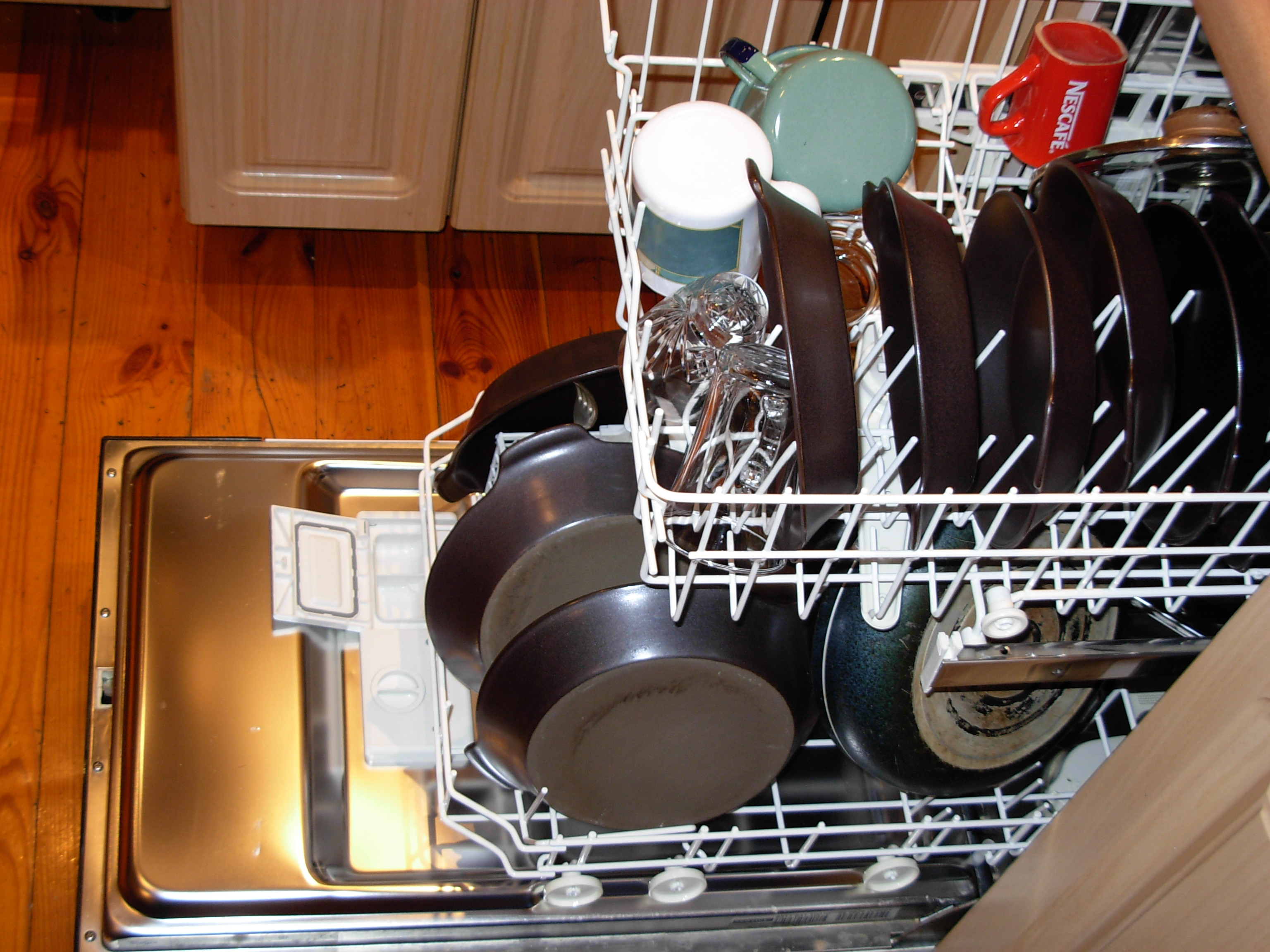 Use a dishwasher instead of washing your dishes by hand in the sink - Cut back on water use - Image courtesy of https://upload.wikimedia.org/wikipedia/commons/e/e0/Dishwasher_with_dishes.JPG