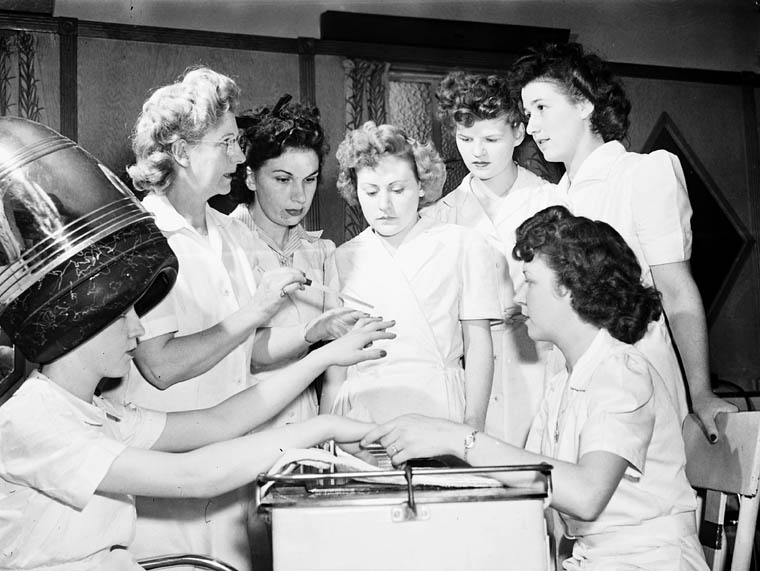Ex-servicewomen learning manicure techniques