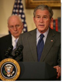 With Vice President Dick Cheney looking on, Pr...