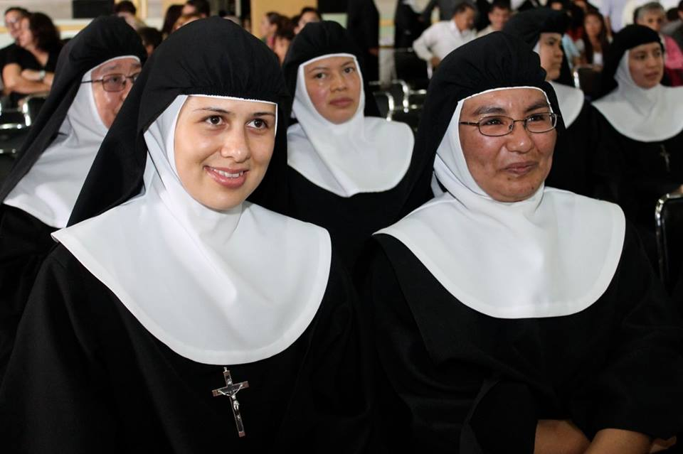 A close-up of nuns sitting