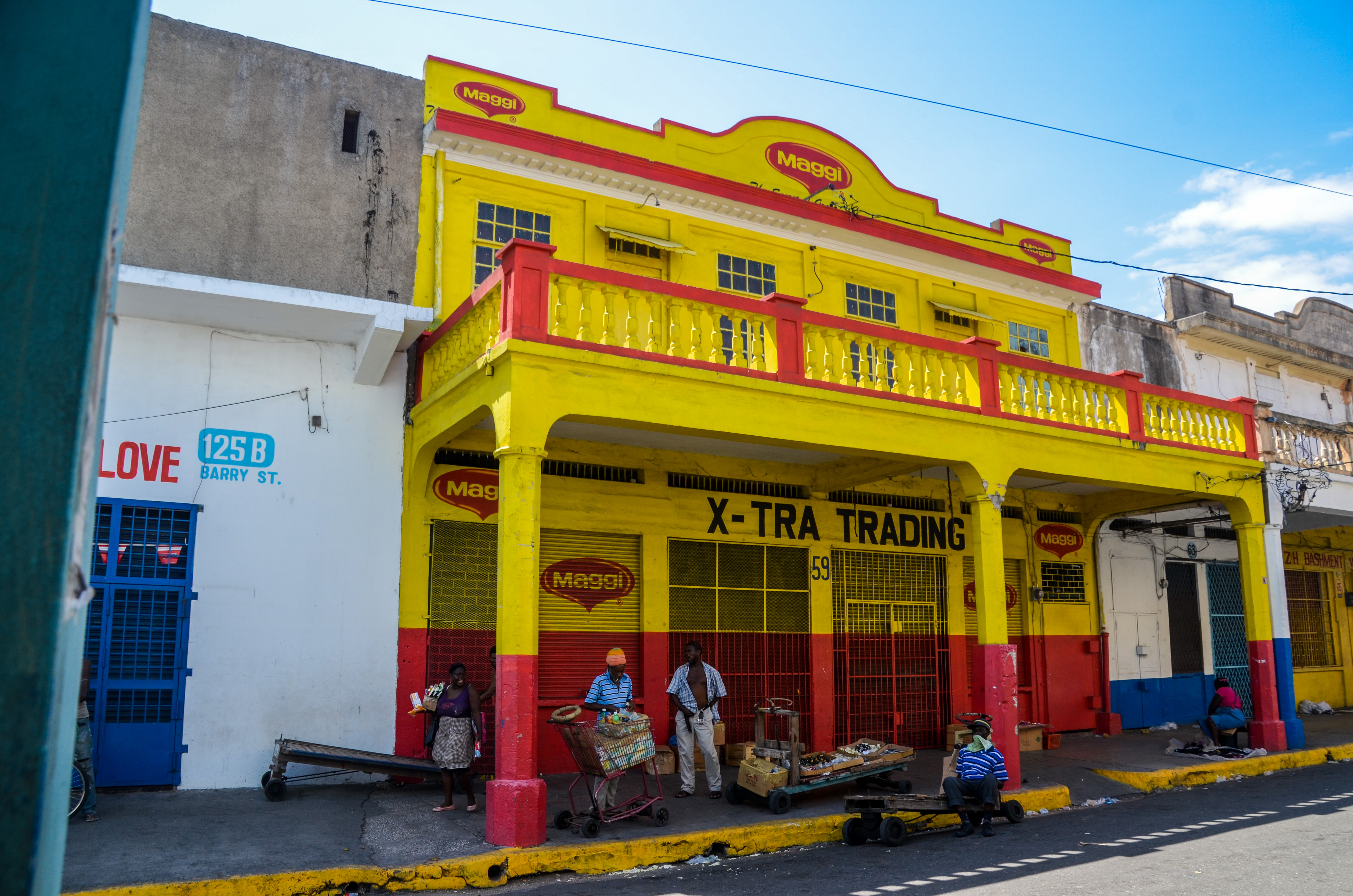 Painted house in downtown Kingston, Jamaica. (33032978752).jpg