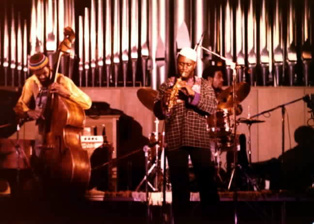 Idris Muhammad playing with [[Reggie Workman]] and [[Pharoah Sanders]], c. 1978