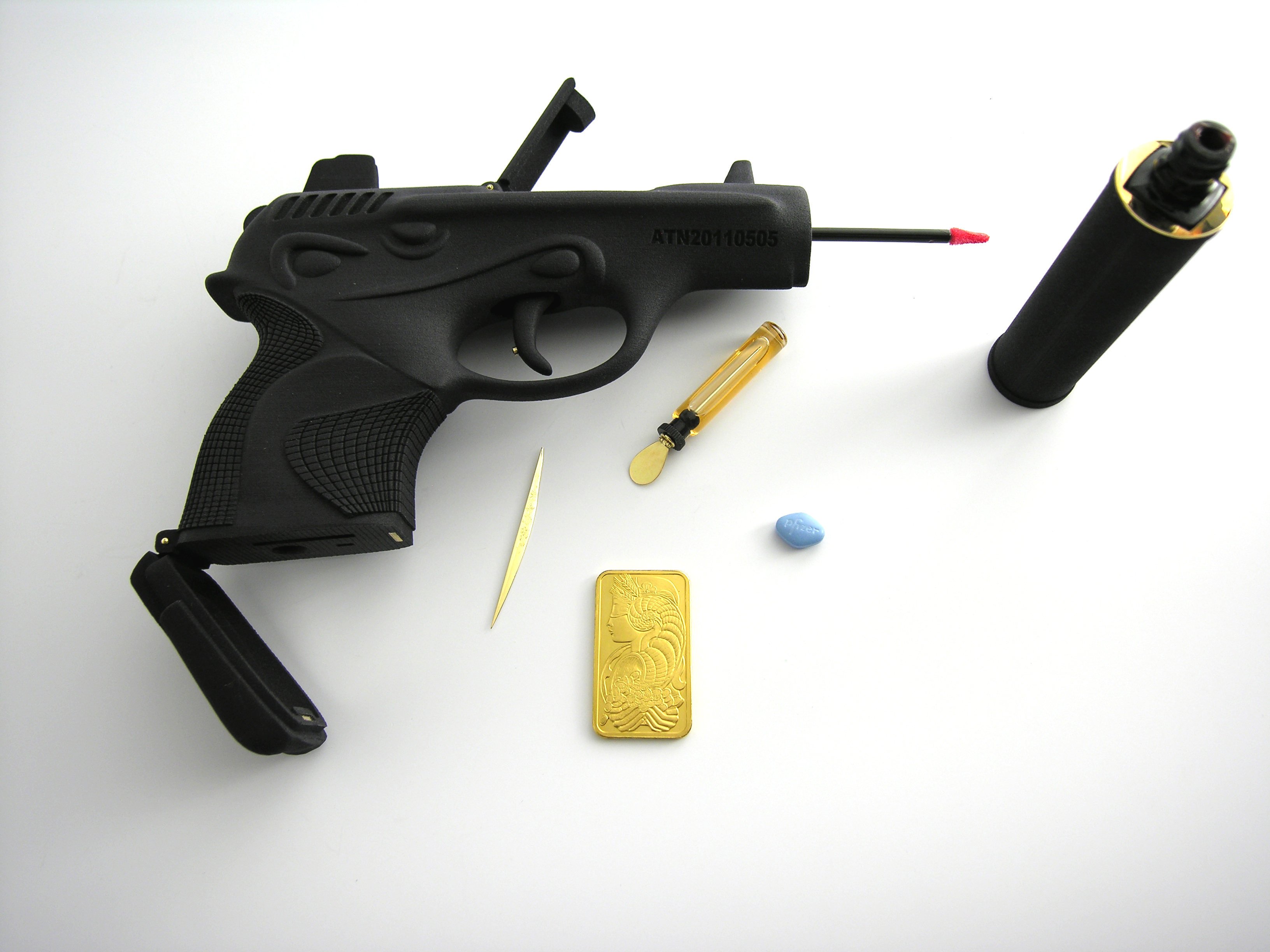 in silencer), the loading chamber serves as a pill compartment (complete with pills, including Viagra), 50 grams of certified and decorated gold bullion