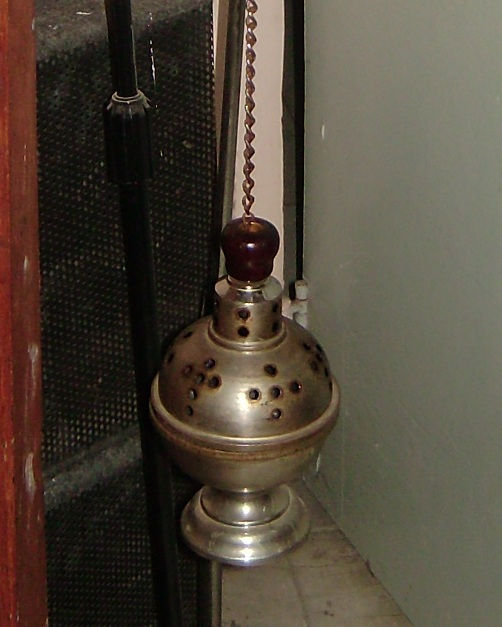 metal censer suspended from chains, in which incense is burned during worship services