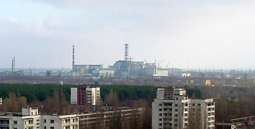 Pripyat with the Chernobyl Nuclear Power Plant in the distance
