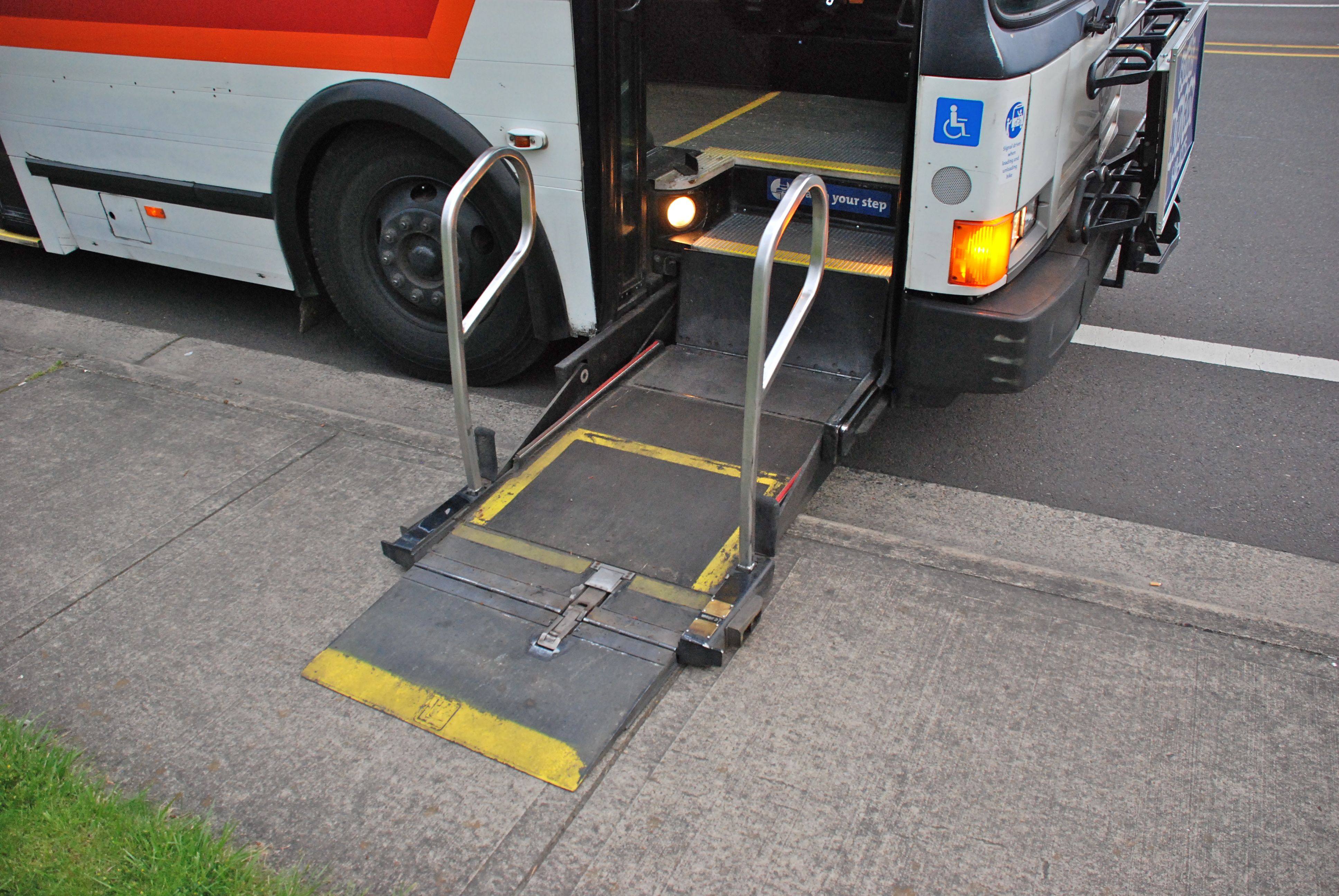 File Wheelchair lift in a 1992 Flxible Metro bus lowered to