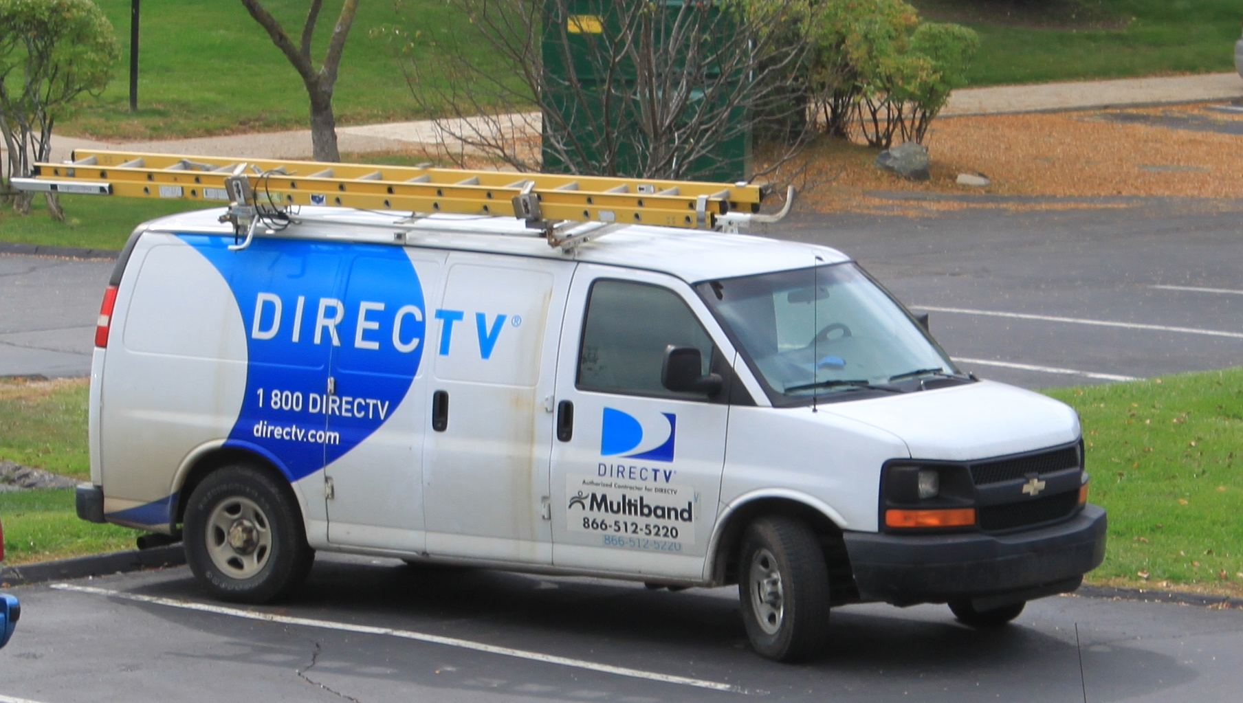 DirecTV service van, Ypsilanti Township, Michigan. DirecTV equipment is installed and maintained by private contractors such as Multiband as shown here. In most areas throughout the United States installation, upgrades, and service are performed by DirecTV home services, a division of DirecTV corporate.