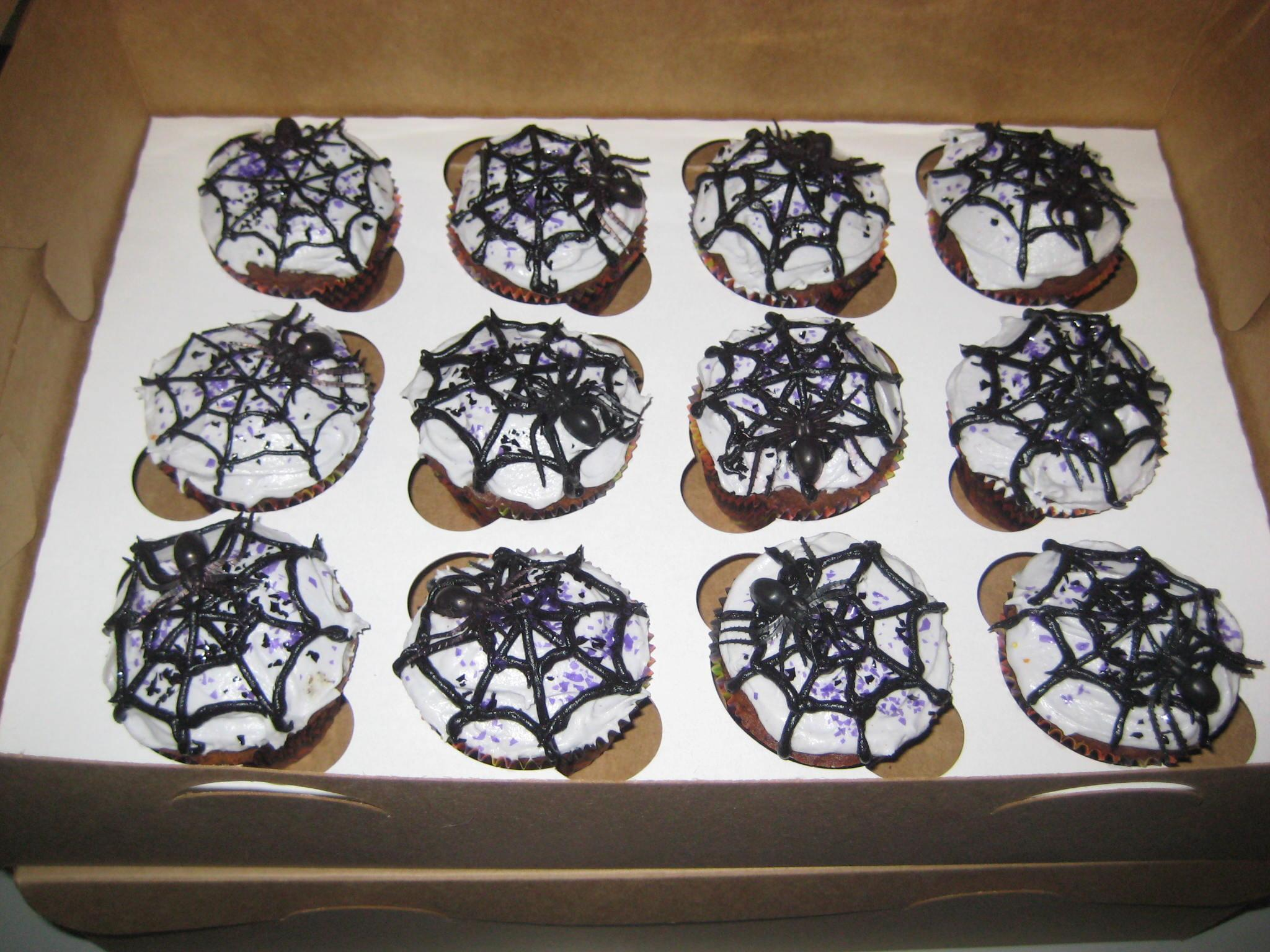 filea dozen spiderweb cupcakes white frosting and black