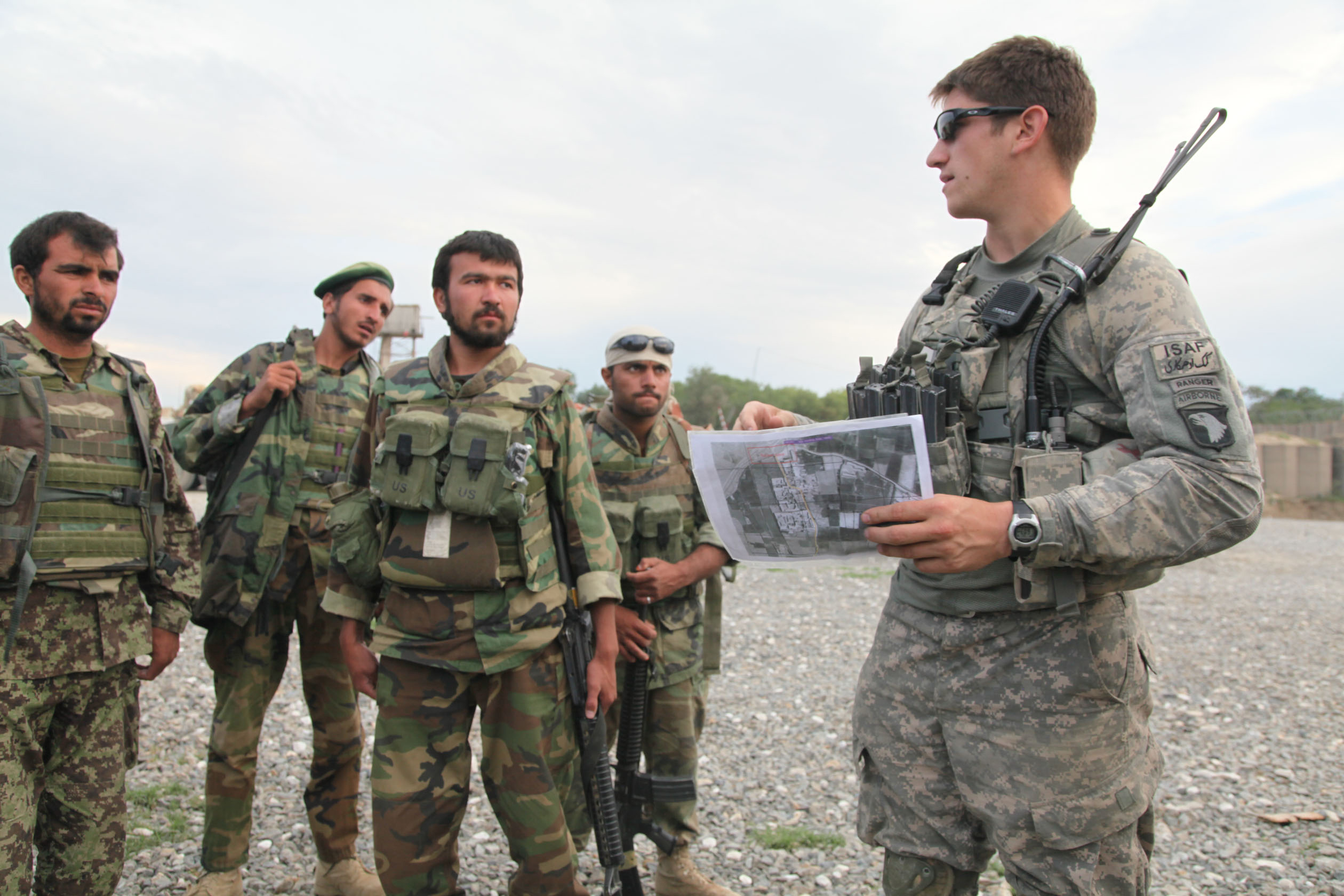 file:u.s. army platoon leader gives a briefing to soldiers from the