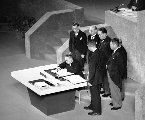 Yoshida and members of the Japanese delegation sign the Treaty. Yoshida signs San Francisco Peace Treaty.jpg