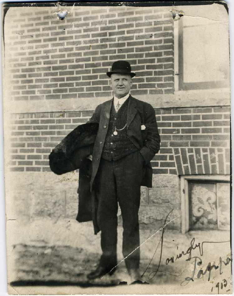 file1913 march 9 man wearing bowler hat winnipeg mb