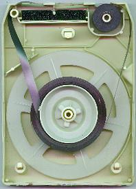 The inside of an 8-track cartridge. The black rubber pinch roller is at upper right.