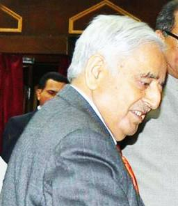 CM J&K,Mufti Mohammed Sayeed and Haji Anayat Ali during his oath ceremony on being elected as Chairman LC on 12 April, 2015 (cropped).jpg