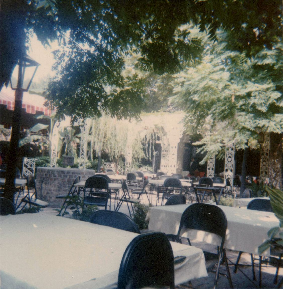Dining tables set up in the courtyard.