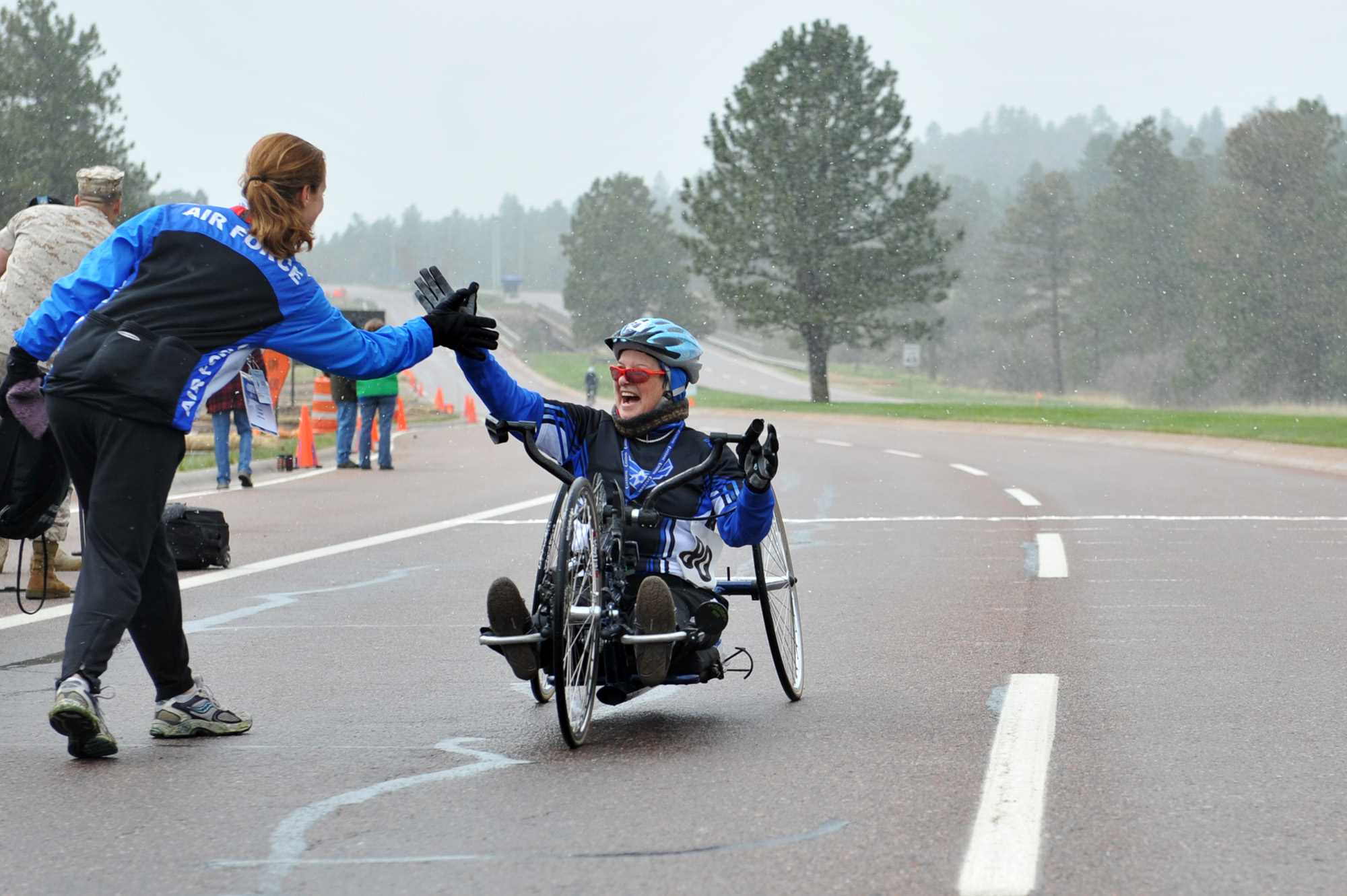 Fileteam air force head coach cami stock gives a high five fileteam air force head coach cami stock gives a high five greeting to jeanne goldy sanitate following her completion of the 10 kilometer hand cycle race kristyandbryce Gallery