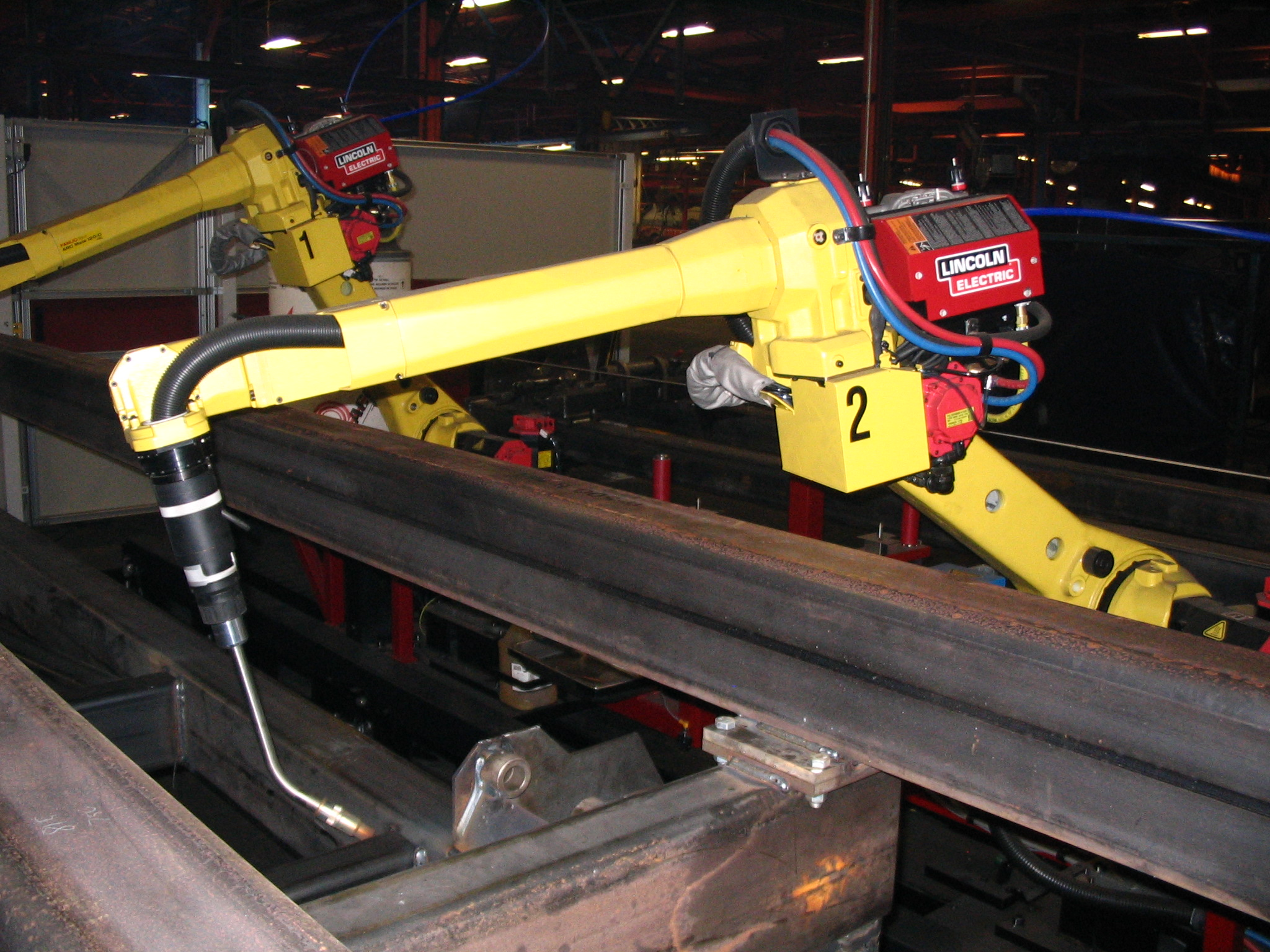 File:FANUC welding robot reaching jpg - Wikimedia Commons