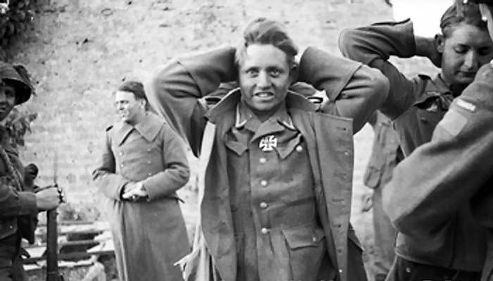 A German prisoner captured by Canadian troops ...