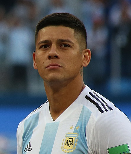 The 28-year old son of father (?) and mother(?) Marcos Rojo in 2018 photo. Marcos Rojo earned a 2.2 million dollar salary - leaving the net worth at 9 million in 2018