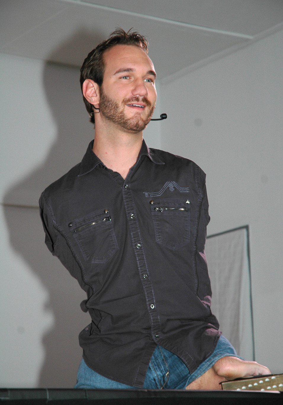 Nick Vujicic, a man with no limbs but two working digits on his left leg stump.