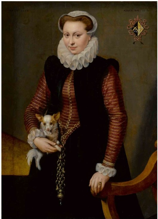 https://upload.wikimedia.org/wikipedia/commons/e/e4/Portrait_of_a_young_woman%2C_aged_17%2C_holding_a_small_spaniel_wearing_a_collar_of_bells_.jpg