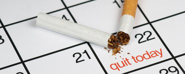 "Cigarette on a calendar with the words ""quit today"""