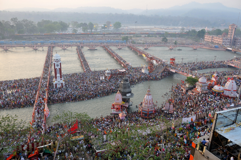 Looking down at millions and millions of people at the Kumbh Mela festival around a river in India