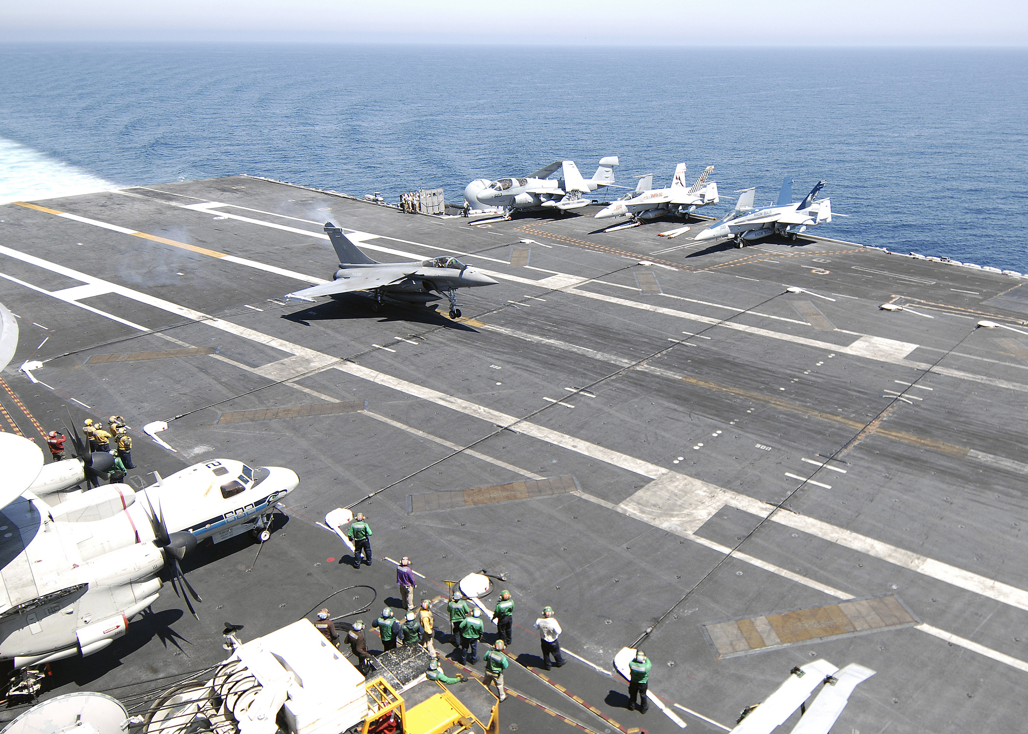 http://upload.wikimedia.org/wikipedia/commons/e/e4/US_Navy_100604-N-2921I-041_A_French_navy_Rafale_F-3_fighter_aircraft_lands_aboard_the_Nimitz-class_aircraft_carrier_USS_Harry_S._Truman_(CVN_75).jpg