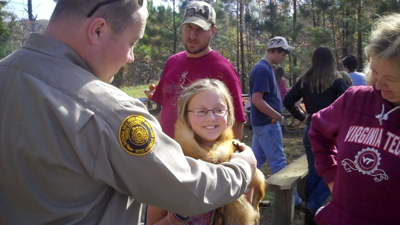 VID00057 (5149425132).jpg A young girl trying the fox pelt on. Date 5 November 2010, 15:16 Source VID00057 Uploaded by AlbertHerring Author
