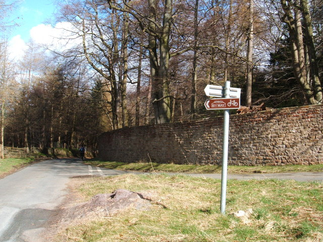 Wall of Swinton Park, with cycling Byway sign - geograph.org.uk - 1223193
